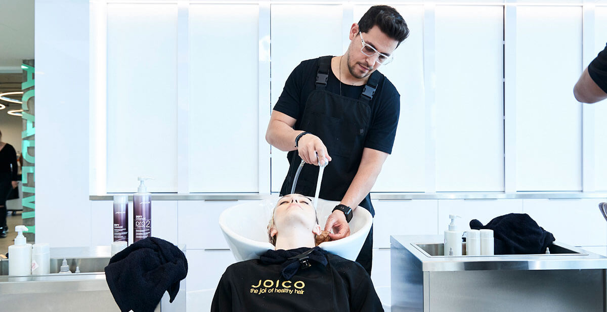 Ricardo Santiago washing models hair